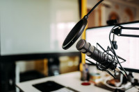Close-up image of a podcast microphone in a studio
