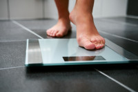 What are the effects of fluoxetine treatment in overweight or obese adults?