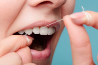 Should we be using dental floss or interdental brushes to help get to the plaque between the teeth?