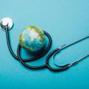 Globe and stethoscope on blue background
