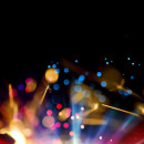 image of colorful sparklers on a dark background