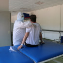Clinician wearing PPE with patient in a hospital setting